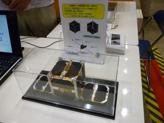 Engineering model of the WE WISH cubesat to be deployed from ISS in September (Meisei Electric Amateur Radio Club). 437.505 downlink (CW beacon, status, and SSTV)